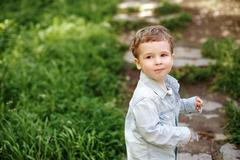 Little Boy Walking in the Summer Park - stock photo