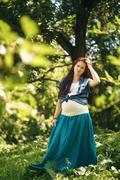 Young Pregnant Woman in the Summer Park - stock photo