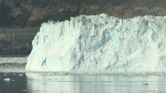 2 minute long still of calving event on glacier wall with resulting waves Stock Footage