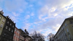 In the old town running clouds on the blue sky Stock Footage