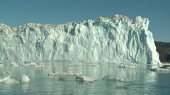 Handheld shot of glacier wall and floating glacier tounge Stock Footage