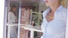 4K Attractive businesswoman looking at paperwork & looking out of window - stock footage