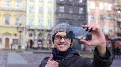 "Man makes selfie in the city<br><a href=""/artist/kycheryavuy"" target=""_blank"">ky Stock Footage"