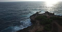 4K AERIAL DOWNARD TILT FLY OVER OF WAVES CRASHING AGAINST ROCKS Stock Footage