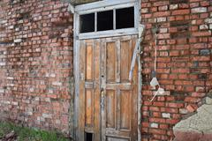 Old door on a dilapidated wall Stock Photos