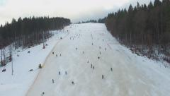 Ski Resort, panorama of Bukovel, skiers descend from the hill, aerial Stock Footage