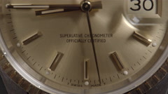 Extreme Close Up of Rolex Oyster Perpetual Date 18k Gold watch.  Stock Footage