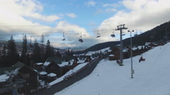 Ski Resort , Skiers ascend on chairlift, aerial Stock Footage