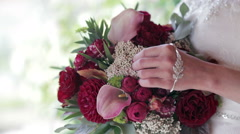 Bride holding a bouquet close-up - stock footage