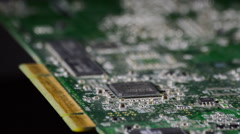 Stock Video Footage of Electronic circuit board rotating at black background
