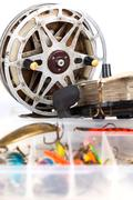 fishing lure in storage box and lading reels - stock photo