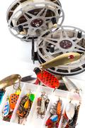 Fishing lure in storage box and lading reels Stock Photos