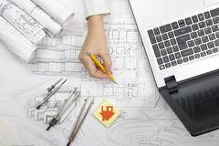 Architect working on blueprint. Architects workplace - architectural project - stock photo