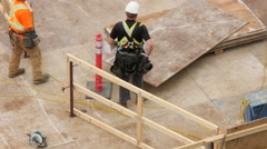 Construction worker on a highrise Stock Footage