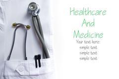 Doctor lab coat pocket with pen, stethoscope, close-up shot isolated on white Stock Photos