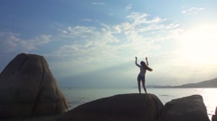 Woman in Headphones Dances Standing Back on a Seascape Background. Slow Motion - stock footage