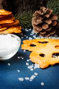 Fresh pretzels with a sea salt on a blue table - stock photo
