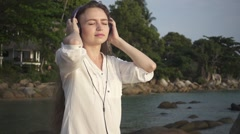 Woman Outdoors Listens Music in Headphones Moving to the Beat. Slow Motion Arkistovideo