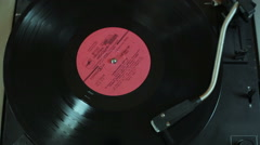 Vinyl disc is spinning in the gramophone close-up Stock Footage