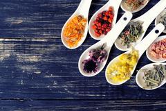 Herbs in ceramic bowls - stock photo