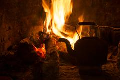 Fire fireplace kettle wood winter holiday Stock Photos