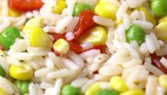 Mix of rice, corn, peas and red sweet pepper, 4K macro dolly shot - stock footage