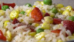 Adding seasoning to rice and vegetable salad, close up 4K video Stock Footage