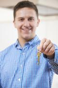 Happy Young Man Holding Keys To New Home - stock photo