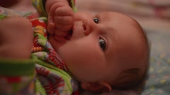 Baby is teething - crying and puts in mouth her fist Stock Footage