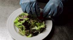 Chef finishing caesar salad Stock Footage