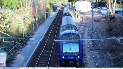Train Passing Under Bridge Stock Footage