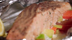 Baked salmon on a pillow of vegetables Stock Footage