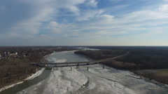 Aerial view of bridge over partially frozen river in Ohio Stock Footage