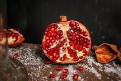 Fresh ripe garnet on table close up - stock photo