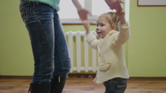Little child girl dancing holding hands with nanny - stock footage