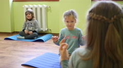 Kids try to perform poses of yoga - asana meditation Stock Footage