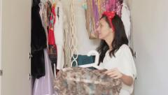Girl puts things out of the closet wardrobe - stock footage