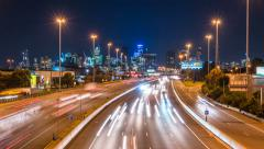 4k timelapse video of highway traffic and cityscape Stock Footage