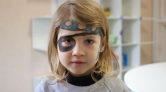 Body art painting on little girl face on family fest portrait look - stock footage