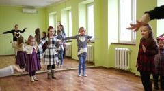 Group of children on a lesson for dancing warm up joints before practice Stock Footage