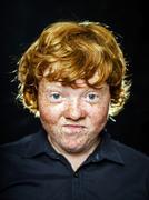 Fat freckled boy portrait Stock Photos