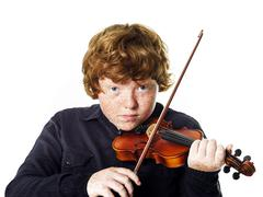 Big fat red-haired boy with small violin - stock photo