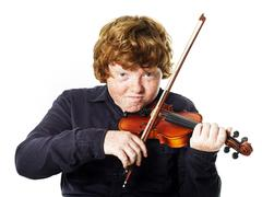 Big fat red-haired boy with small violin Stock Photos