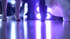 Bride dancing in the middle of party goers on the dance floor in the spotlight Stock Footage