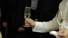 Barman serves a glass of champagne each guest who arrived at wedding party - stock footage