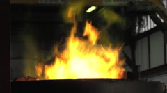 Lost wax bronze casting in a foundry - stock footage