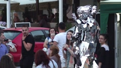Actors dressed in a suit of mirrors was walking on the street festival Stock Footage