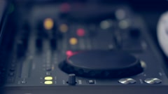 Console mixer sitting on a table in front of the dance floor Stock Footage