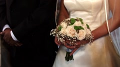Bouquet of roses on which bride keeps in hand to religious service in which Stock Footage