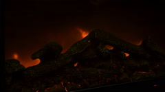 Glowing coals and fire flames in fireplace with metal grating Stock Footage